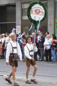 young boys wearing traditional Lederhose during opening ceremony to Oktoberfest