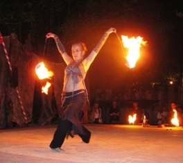 Lydia dancing with fire in her hands